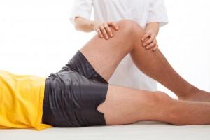 Traitement ostéopathique sur un sportif blessé